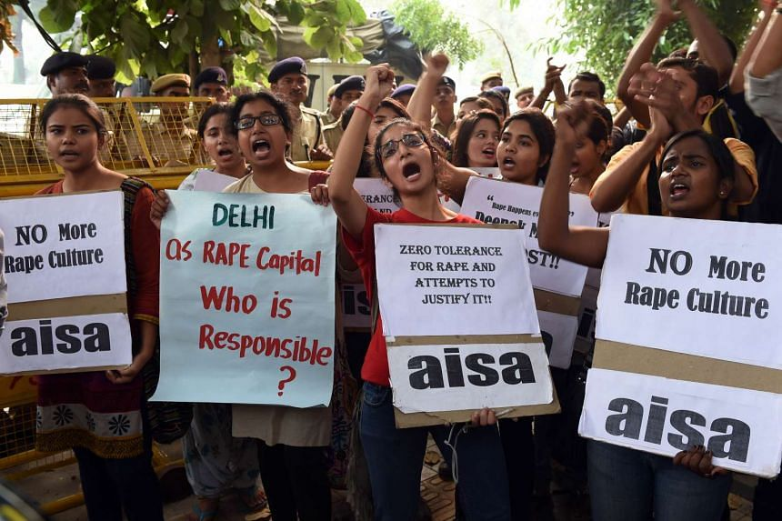 Indian students shouting slogans during a protest against rape in New Delhi on Oct 18, 2015.