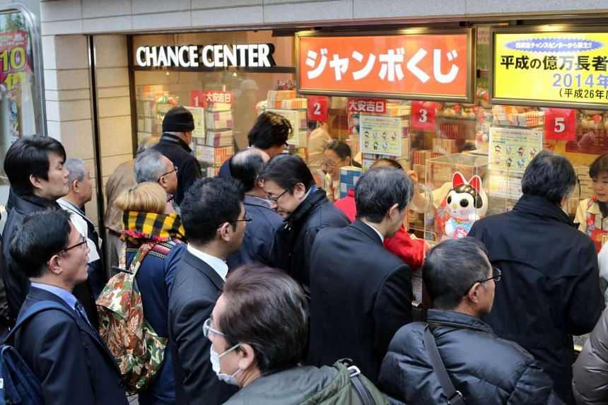 """People queuing up to buy tickets for the 1 billion yen (S$11.7 million) """"Year-end Jumbo Lottery"""", in Tokyo on Nov 25, 2015."""