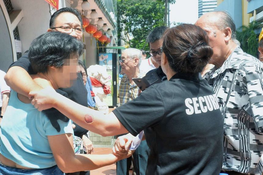 The woman who bit the security guard was told to leave because she had interrupted the vote.