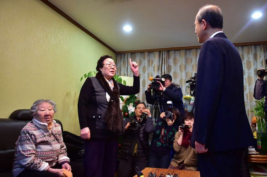 "Former South Korean ""comfort woman"" Lee Yong Soo (second left) protesting during South Korean First Vice-Foreign Minister Lim Sung Nam's visit to a shelter for the women in Seoul on Dec 29, 2015."