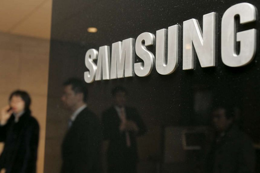 Employees at Samsung Group walk at the group headquarters in Seoul.