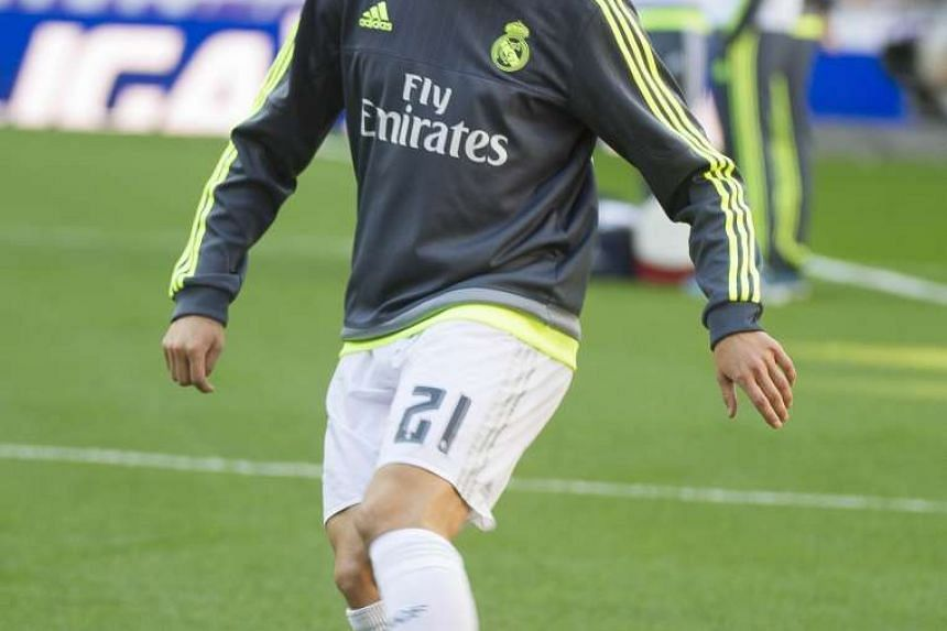 Real Madrid's Russian midfielder Denis Cheryshev warms up before the Spanish league football match Real Madrid CF vs Getafe CF at the Santiago Bernabeu stadium in Madrid on Dec 5, 2015.