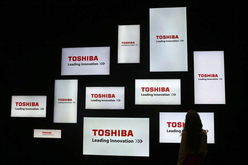 A visitor looking at a display of Japan's Toshiba company during the IFA Electronics show in Berlin.