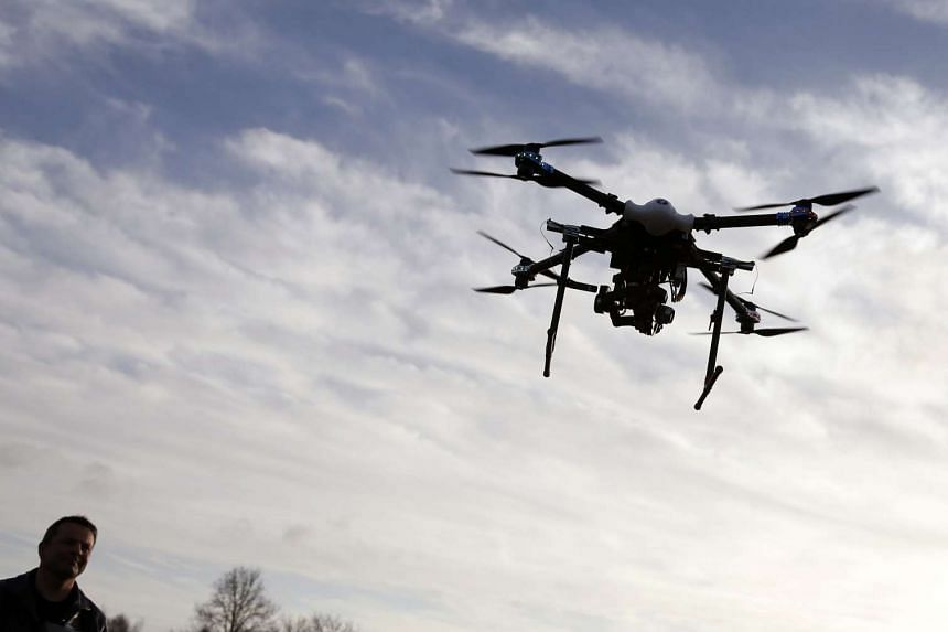 A small recreational drone hovered near President Barack Obama's motorcade in Hawaii.