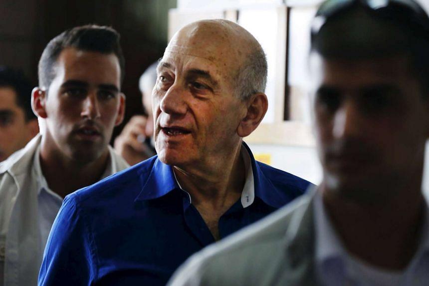 Former Israeli Prime Minister Ehud Olmert leaving Tel Aviv District Court, on May 13, 2014.