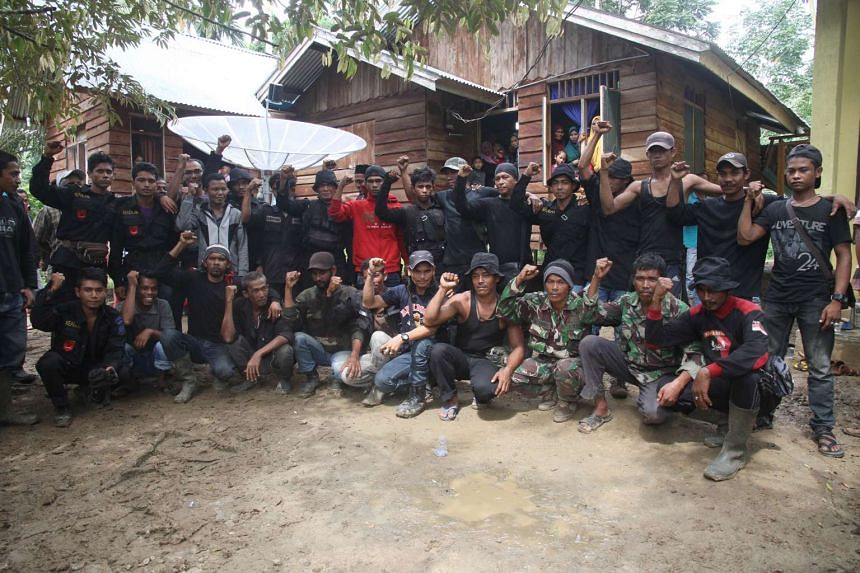 Members of the separatist group pose for a photo after surrendering on Dec 29, 2015.