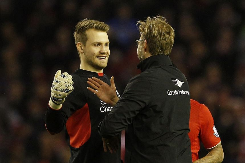 Liverpool manager Juergen Klopp celebrates with Simon Mignolet after the game on Dec 26.