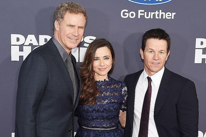 Cause to celebrate: The stars of Daddy's Home (above from left) Will Ferrell, Linda Cardellini and Mark Wahlberg, and actress Jennifer Lawrence from Joy at the premieres of their movies in New York.