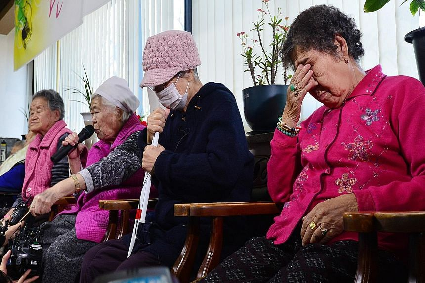"""Former South Korean """"comfort woman"""" Lee Ok Sun speaking during a news conference at a special shelter for former wartime sex slaves in Gwangju, South Korea, yesterday. There were mixed reactions among the women to the agreement between the two govern"""