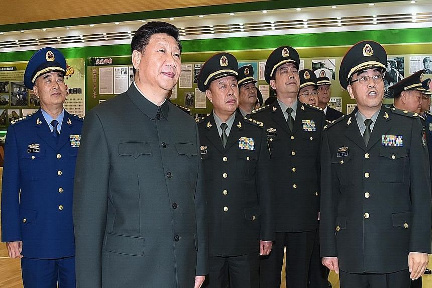 President Xi (second from left) visiting the PLA Daily's headquarters last Friday to commemorate the paper's 60th anniversary. Mr Xi called on the paper to play a leading role in strengthening the military during his visit.