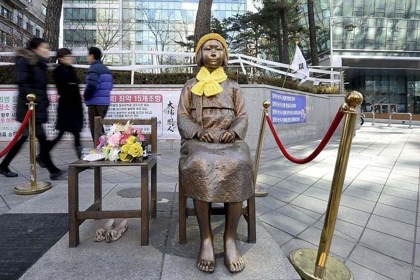 The bronze statue of a barefoot girl in a traditional hanbok dress in front of Japan's embassy in Seoul has become a symbol of comfort women. It will take an act of political courage in Seoul to relocate the statue, which has served as a potent symbo