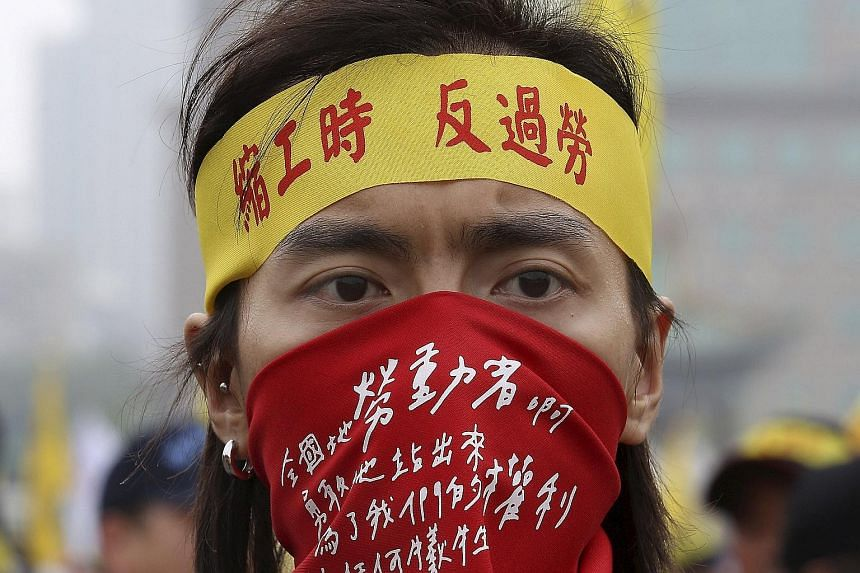 A demonstrator in a Labour Day protest in front of the presidential office in Taipei on May 1. The dissatisfaction among youth over the job situation has boiled over into student protests and become a hot-button issue for voters.