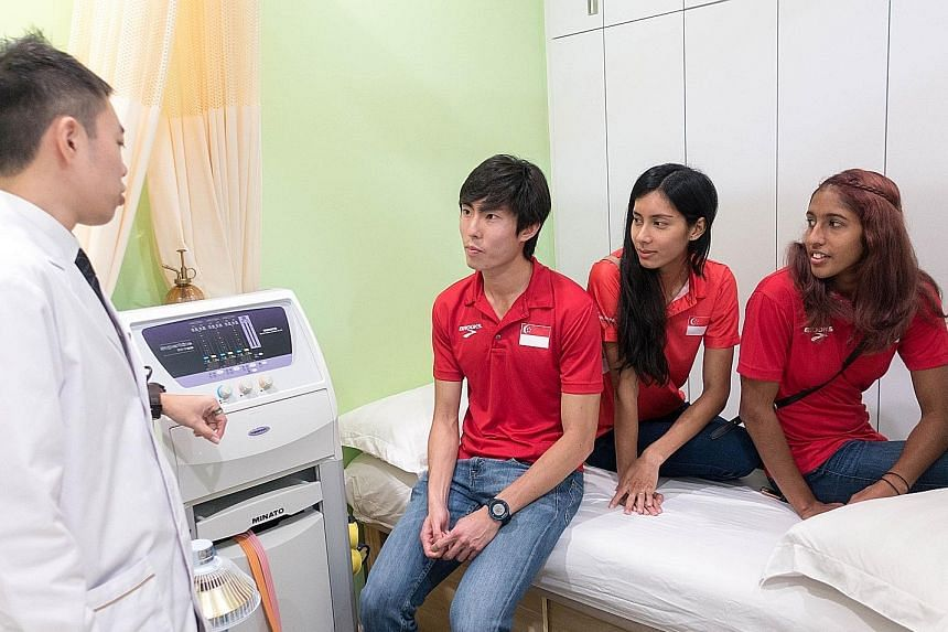 Singapore Athletics yesterday inked a one-year, $280,000 sponsorship with home-grown traditional Chinese medicine firm Kin Teck Tong. National athletes such as (from left) Soh Rui Yong, Dipna Lim-Prasad and Shanti Pereira will benefit from the firm's