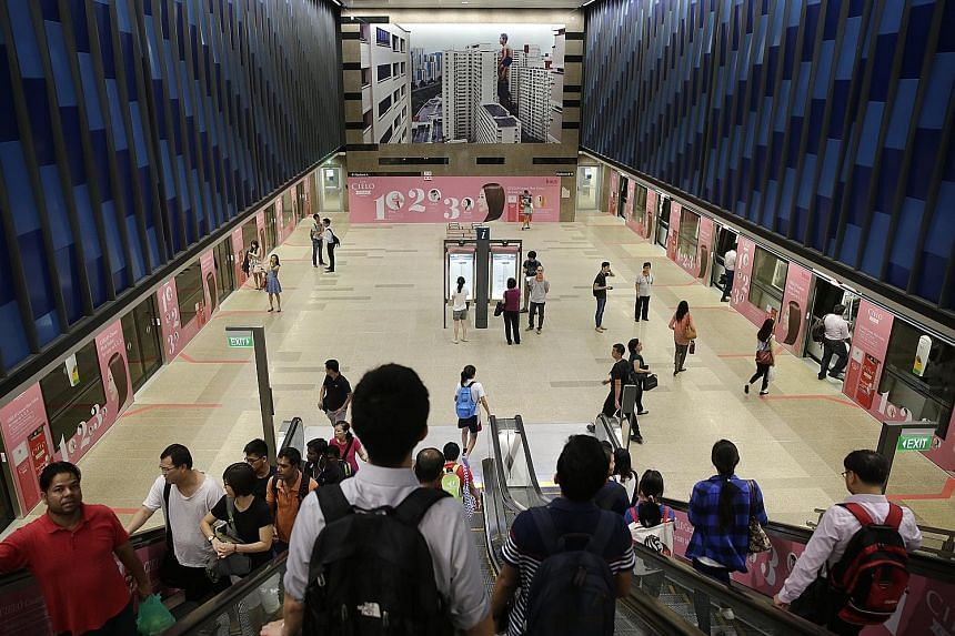 A light morning peak-hour crowd at the Bukit Panjang MRT station yesterday. The 16.6km Downtown Line 2, comprising 12 stations, connects the estate to places such as Little India, Bukit Timah and Bugis - with stops including Botanic Gardens and food