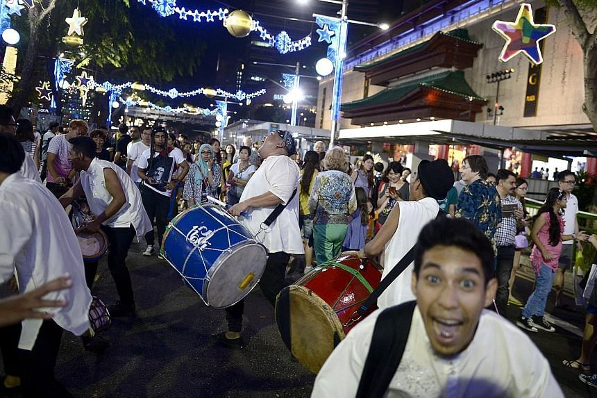 Visitors taking in a street performance on Pedestrian Night in Orchard Road in January. The upcoming event this Saturday will feature drummer Brandon Khoo and a cappella group MICappella, among other performances.