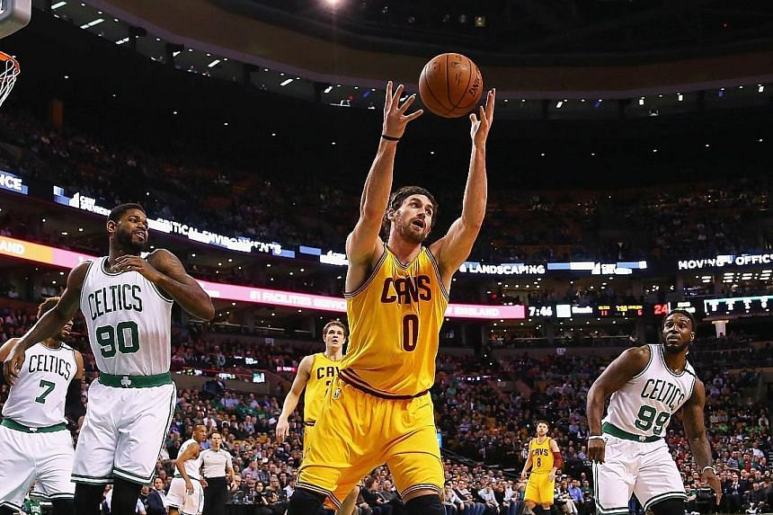 Kevin Love of the Cleveland Cavaliers grabbing a rebound against the Boston Celtics. His rebounds are a key factor in the trademark long passes to his team-mates.