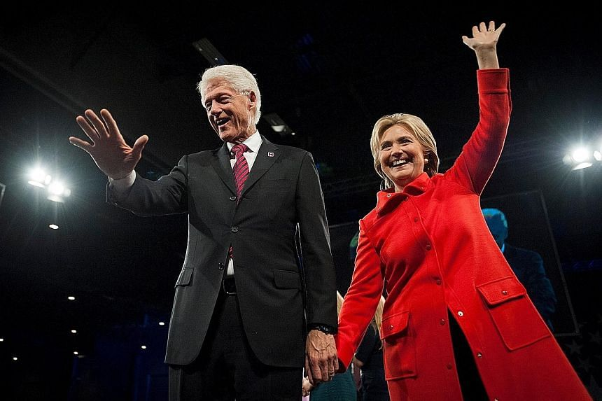 """Former US president Bill Clinton and his wife, Democratic presidential candidate Hillary Clinton, greeting the crowd in Des Moines, Iowa, in October. Said Assistant Professor of Politics Hans Hassell from Cornell College: """"Having Bill Clinton involve"""