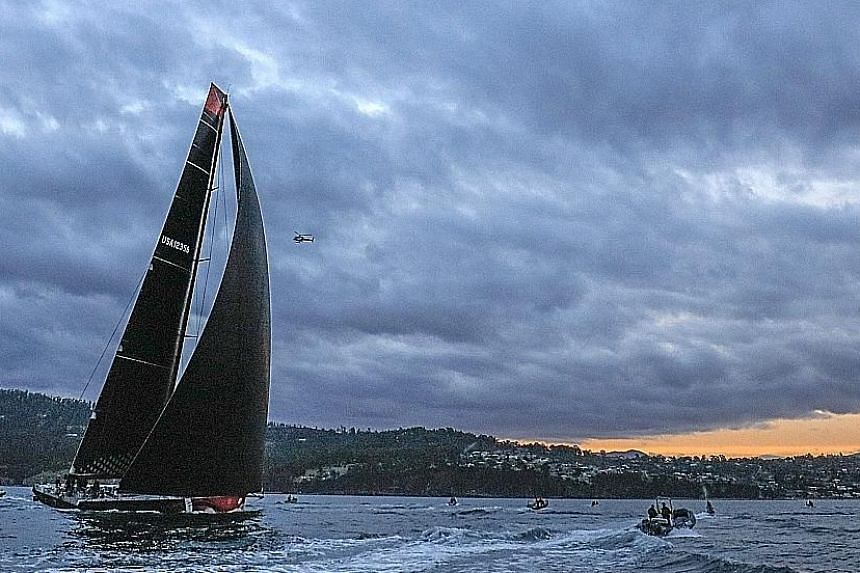 "Comanche close to the finish line in Hobart last night, as skipper Ken Read's decision to ""punch on through"" and make running repairs to one of the broken twin rudders and daggerboard paid off."