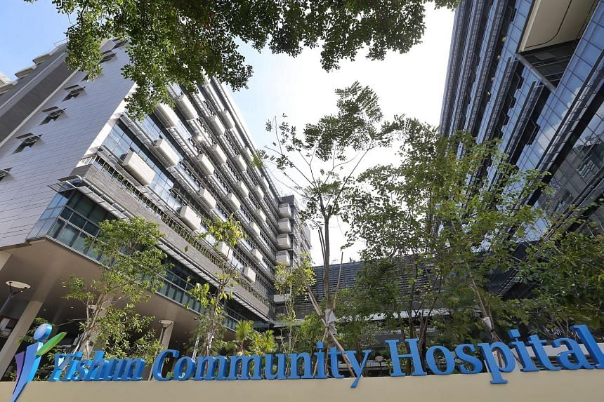 A patient being moved from bed to toilet with the help of a hoist (above). With these hoists, two nurses are able to move a heavy, non-ambulatory patient from bed to chair or bathroom. The newly opened Yishun Community Hospital (below) has four of th