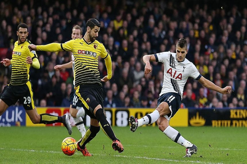 Erik Lamela (right) rifling in the opening goal for Tottenham against Watford at Vicarage Road yesterday. Spurs climb to third in the EPL standings with the 2-1 away win.