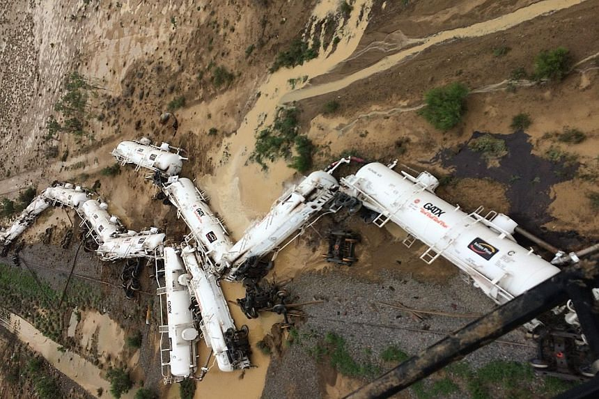 A police handout photo of the freight train carrying 200,000 litres of sulphuric acid that derailed near the town of Julia Creek in Australia. Police said there had been a minor leakage of sulphuric acid and spillage of diesel fuel from the accident