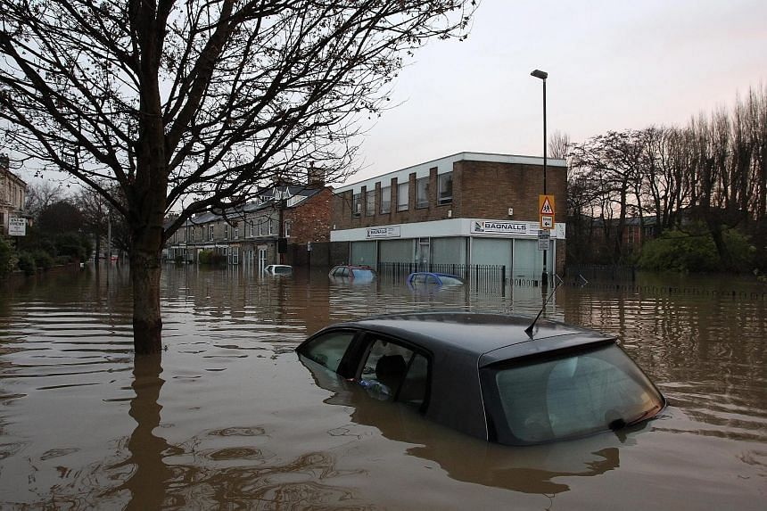 Streets and about 500 properties in the historic city of York were flooded after two rivers burst their banks on Sunday.