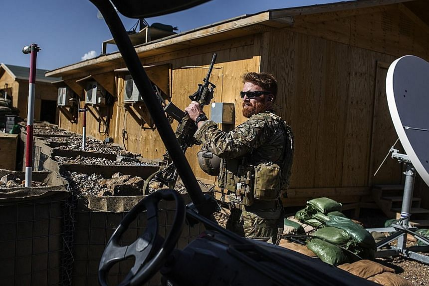 A US special forces soldier in Afghanistan's Parwan province last year. During the peak of the wars in Iraq and Afghanistan, nearly 13,000 Special Operations forces were deployed on missions across the globe, but were mostly assigned to those two cou
