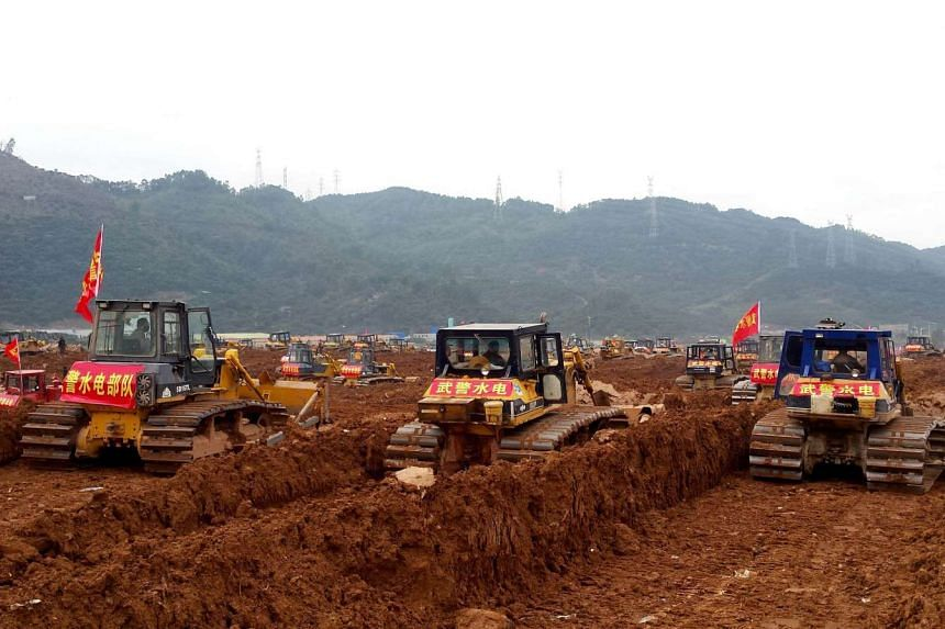 Excavators are seen working at the site of the Shenzhen landslide on Dec 28, 2015.