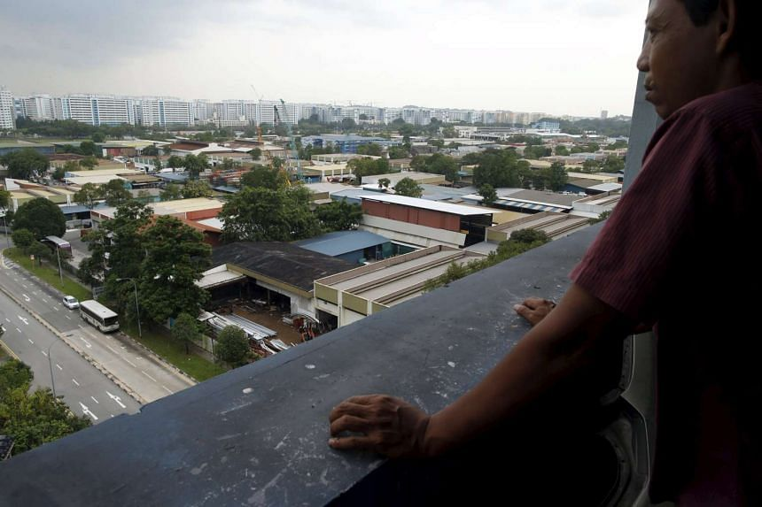 A man looking at a cluster of factories at an industrial park in Singapore.