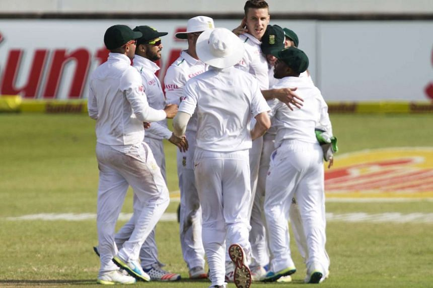 South Africa team celebrating the wicket of England's Nick Compton (not in picture).