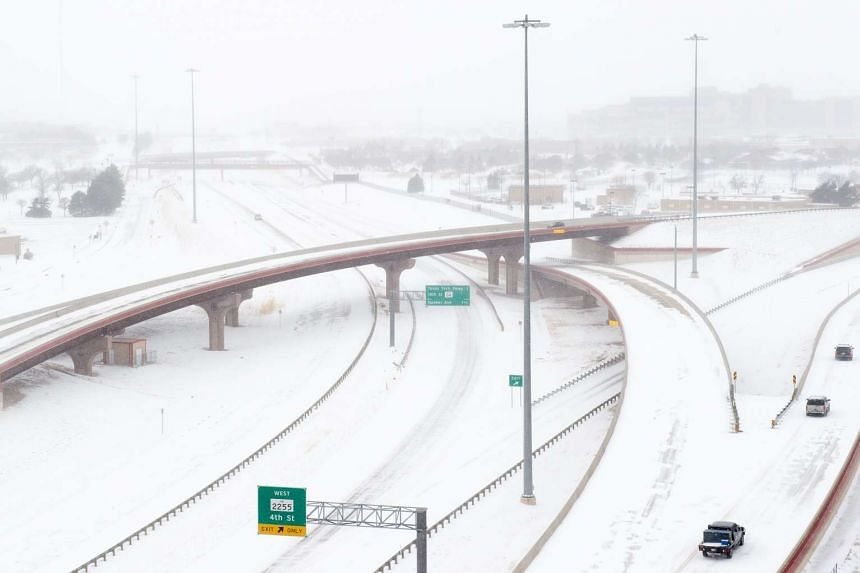 Snow blankets Marsha Sharp Freeway in Lubbock, Texas on Sunday, with as much as 13 inches of snow forecast for parts of the US state.