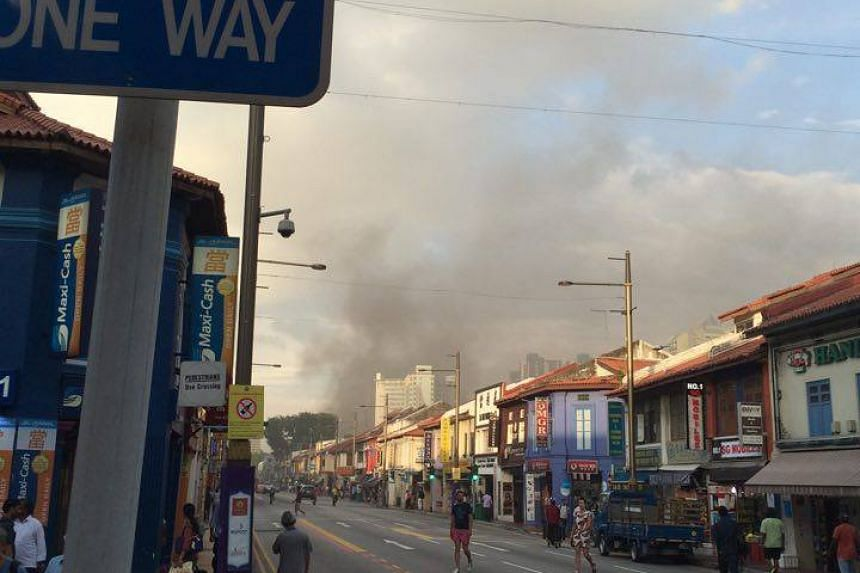 Dark smoke rising from the fire which broke out in a condominium on Sturdee Road.