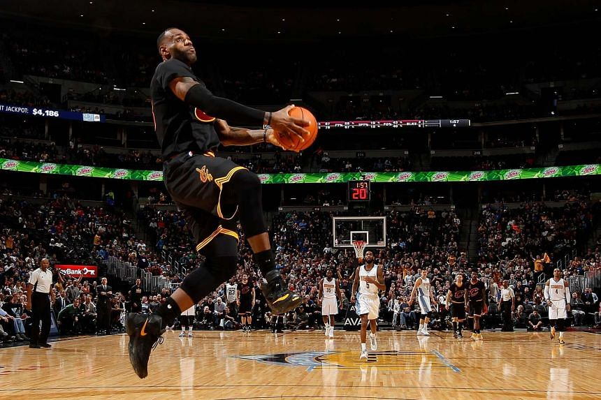 LeBron James of the Cleveland Cavaliers goes up for a dunk against the Denver Nuggets on Dec 29, 2015.