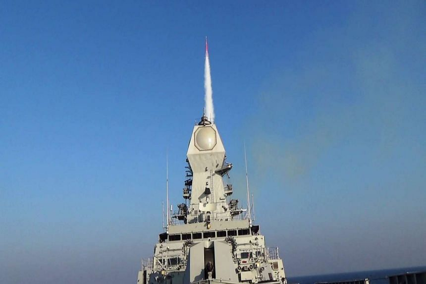 A missile taking off from INS Kolkota, the Indian Navy's indigenous stealth destroyer.