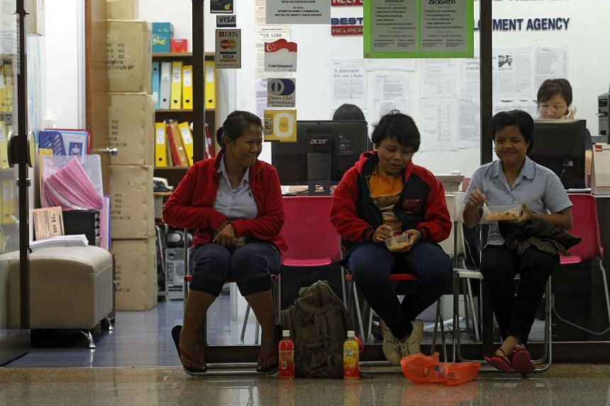 A maid employment agency in Coronation Shopping Plaza on March 14, 2014.
