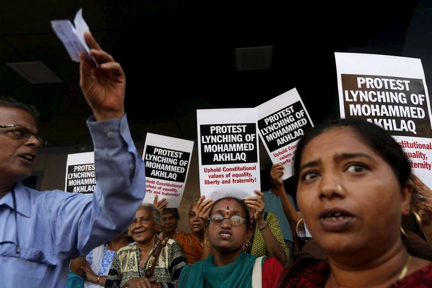 Demonstrators shout slogans during a protest against the killing of Mohammed Akhlaq, who was lynched by a mob after they thought he slaughtered a cow, in Mumbai on Oct 6, 2015.
