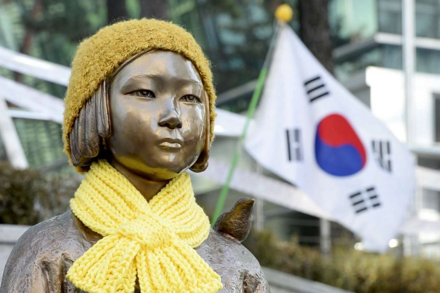 """A statue representing """"comfort women"""" of the Japanese military during World War II in front of the Japanese embassy in Seoul, South Korea."""