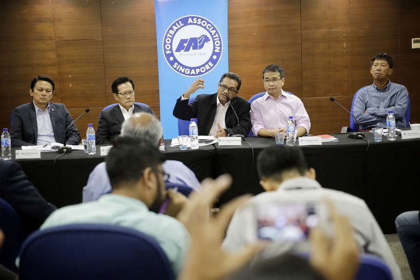 Football Association of Singapore (FAS) members speaking to the media during a post-Annual General Meeting (AGM) press conference.
