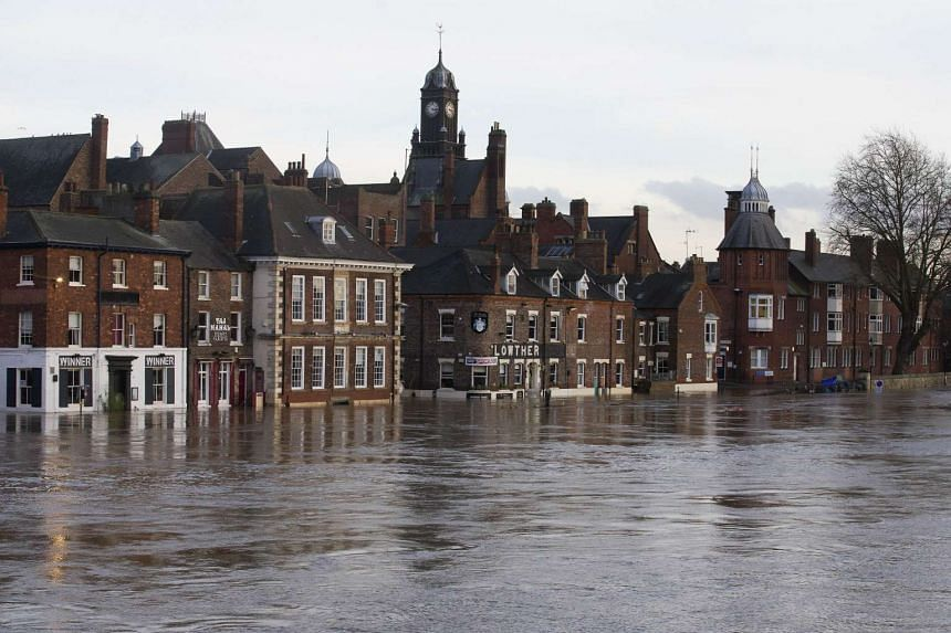 Submerged buildings overlooking the river Ouse are pictured late in the afternoon in York, northern England, on Dec 29, 2015.