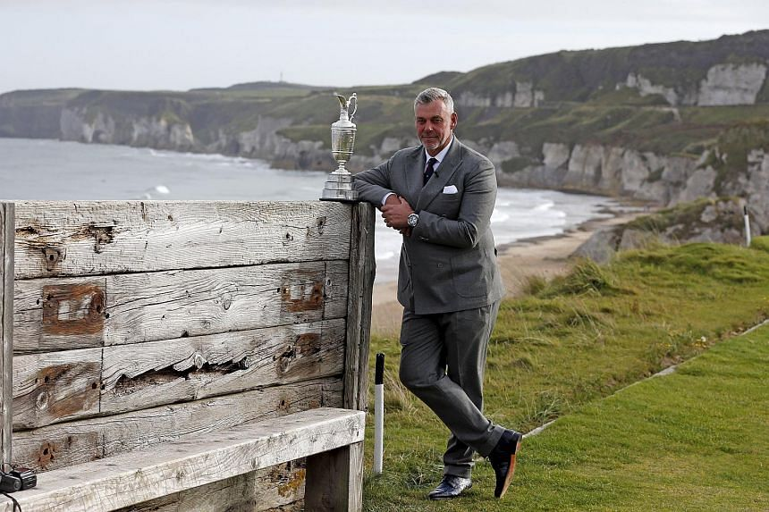 2011 British Open Champion Darren Clarke poses with the Claret Jug trophy at the Royal Portrush Golf Club.