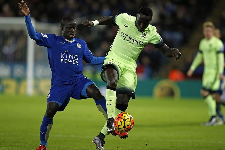 Leicester City's French midfielder N'Golo Kante (left) vies with Manchester City's French defender Bacary Sagna during the English Premier League football match on Dec 29, 2015.