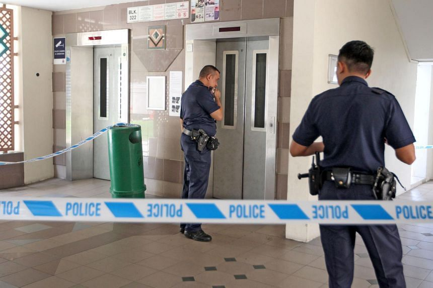 Police examining the lift where the incident happened in October.