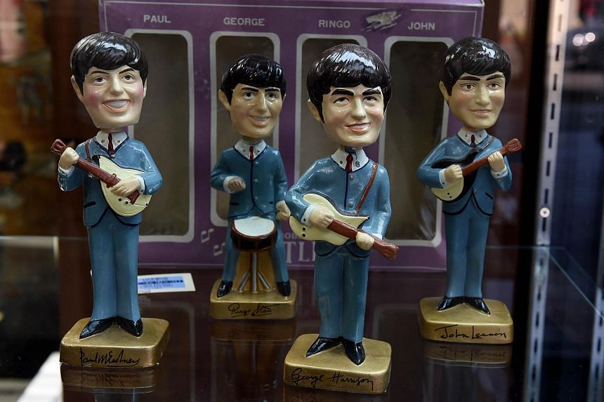 Beatles dolls are displayed, during an auction preview in California on Sept 9.
