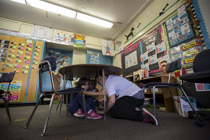 A teacher and students from a Los Angeles school are seen in an earthquake drill on Oct 15.