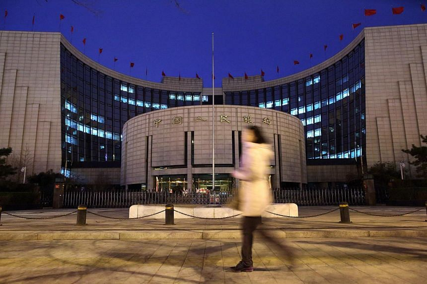 A pedestrian walking past the People's Bank of China headquarters in Beijing.