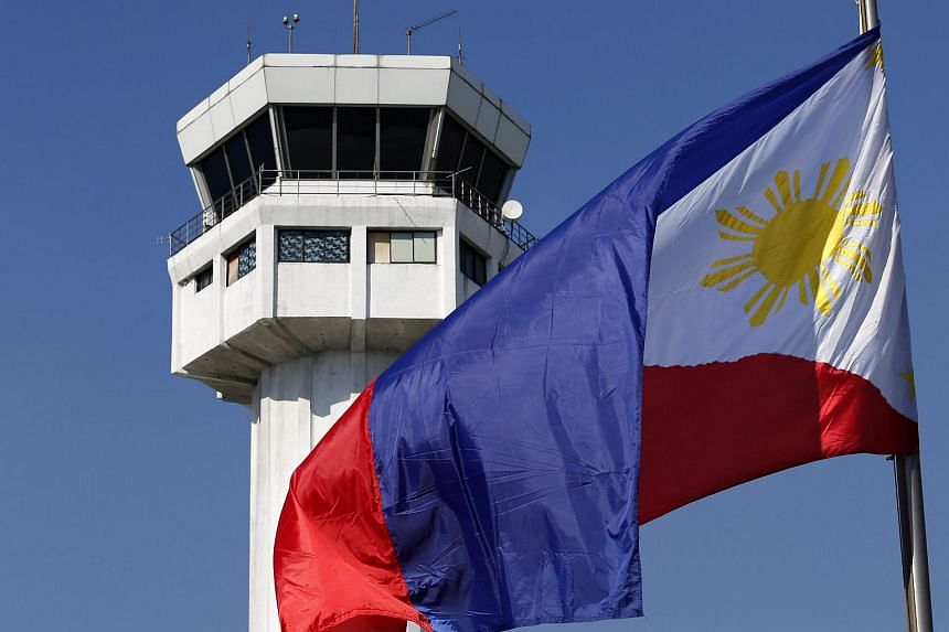 A Philippine flag flying at the international airport in Manila on Dec 28.