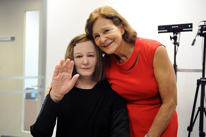 Prof Nadia Thalmann (left) with Nadine, a humanoid that looks almost like a human, with a full head of hair and dewy skin. Researchers hope in future, Edgar 2 (below), now still in a research phase, can be placed in public venues to give practical in
