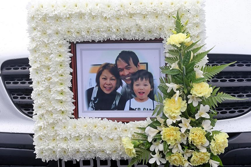 The coffin (left) of six-year-old Rayshon Lim (above) being carried out of the funeral parlour in Sin Ming Drive yesterday. Rayshon was travelling with his parents Barnabas Lim and Kristen Ng (both above) in Malaysia when they were killed in a car cr
