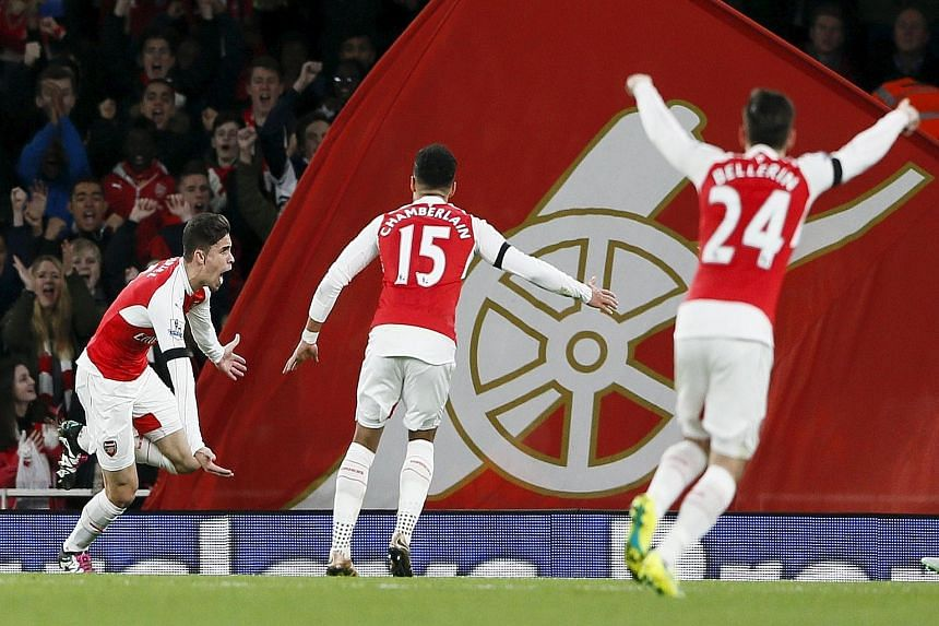 Arsenal's Gabriel Paulista (left) celebrating with team-mates Alex Oxlade-Chamberlain and Hector Bellerin after scoring the first goal against Bournemouth.