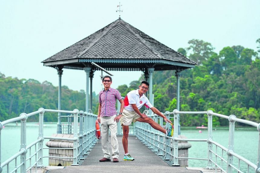 Mr Yong (right) and Mr Lim ran 2,500km - 50km daily over 50 days - to mark SG50.